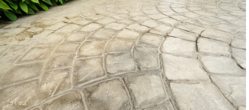 Pros and Cons of Stamped Concrete vs Pavers Around Your Pool